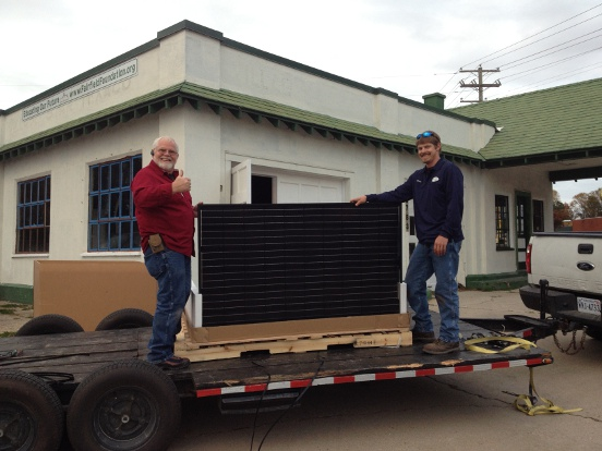Charles Bush (left) and son of Off-The-Grid-By-Design install the Dominion Power sponsored solar panels at the CAPE.